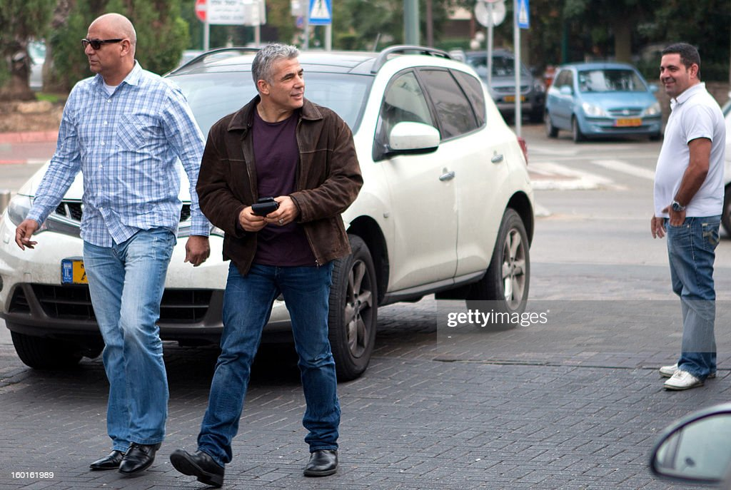 Politician Yair Lapid arrives at the Yesh Atid headquarters in Tel Aviv January 27, 2013, for a party meeting. Israeli Prime Minister Benjamin Netanyahu has offered Yesh Atid leader Yair Lapid, Israel's newest political star, the post of foreign minister or finance minister in a new government, a newspaper reported on January 25.