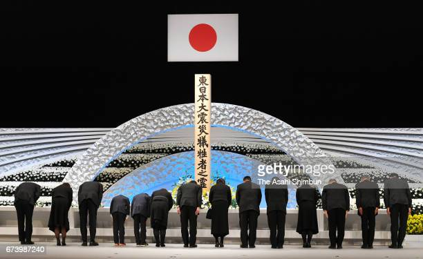Politicians bow toward an altar during the memorial ceremony on the sixth anniversary of the Great East Japan Earthquake and following tsunami at the...