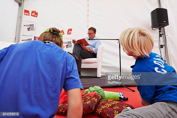Politicians of the SPD party read fairy tales for children at the 150th anniversary of the SPD Party celebrated at the Brandenburg Gate in Berlin /...