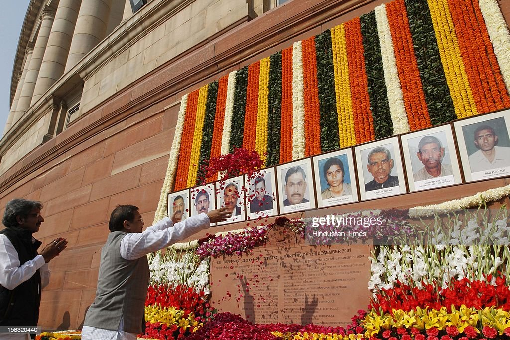 Politicians pay homage to martyrs during a remembrance ceremony of the 2001 Parliament attack, at Parliament House on December 13, 2012 in New Delhi, India. Politicians gathered to observe the eleventh anniversary of a bloody militant attack on the complex, which left 14 dead on December 13, 2001.