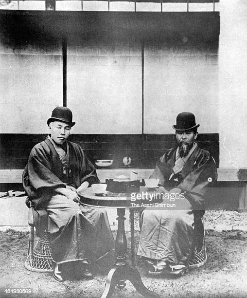 Politicians Shigenobu Okuma and Hirobumi Ito pose for photographs at Ito's villa in April 1897 in Oiso Kanagawa Japan Ito was four time Prime...