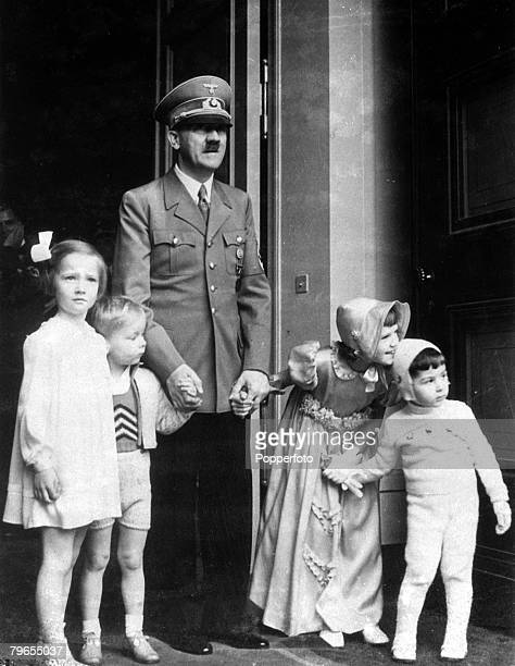 Politics 20th April 1939 Berlin Germany German Chancellor and Nazi dictator Adolf Hitler holds hands with children who had called to wish him a happy...