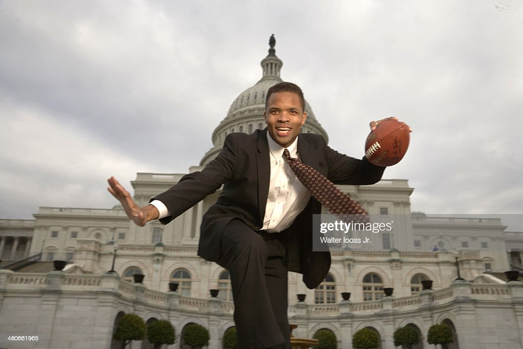 Casual portrait of Illinois congressman <a gi-track='captionPersonalityLinkClicked' href=/galleries/search?phrase=Jesse+Jackson+Jr.&family=editorial&specificpeople=1107074 ng-click='$event.stopPropagation()'>Jesse Jackson Jr.</a> posing during photo shoot in front of Capitol Building. Jackson, who took office in the House of Representatives in December 2005, was a running back on the football team at North Carolina Agricultural and Technical State University. Walter Iooss Jr. F0 )