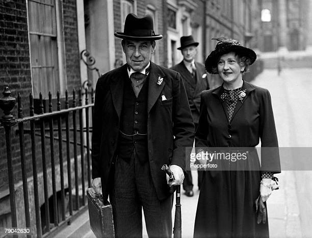 Politics London England 24th April 1945 Sir John Anderson the Chancellor of the Exchequer pictured with his wife leaving Downing Street for the...
