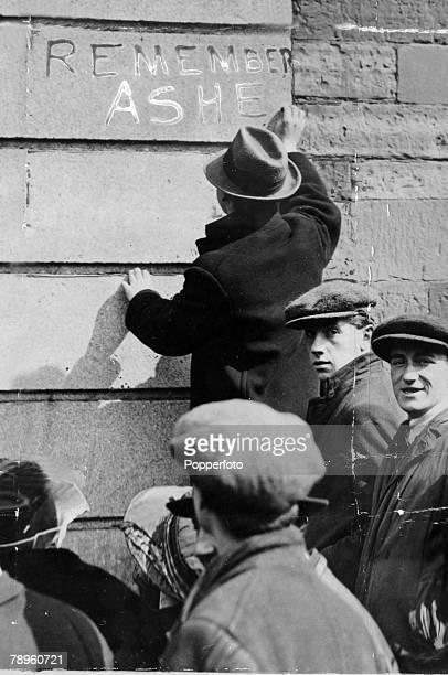 April 1920 Sinn Fein sympathisers chalking the words 'Remmeber Ashe' on a public buiding in Dublin to recall the memory of Sinn Fein hunger striker...