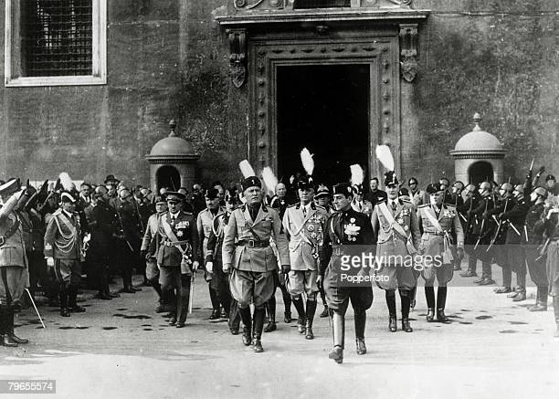 October 1934 Italian fascist dictator Benito Mussolini pictured centre left in Rome's Piazza Venezia where he was about to inspect troops of the...