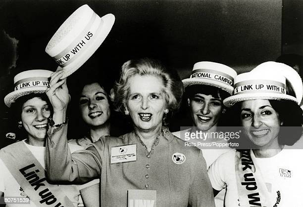 5th October 1976 Brighton England Conservative Party leader Margaret Thatcher borrows a straw boater from a group of young Conservatives at the party...