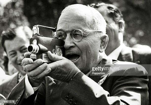 1948 Washington President Harry S Truman tries out a miniature movie camera presented to him by the White House Press Corps President Truman became...