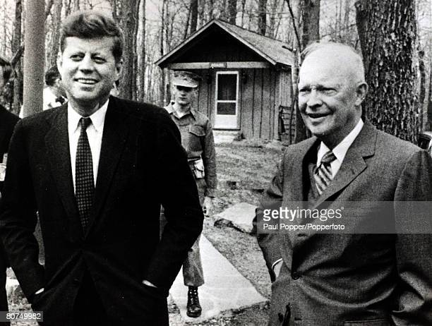 1961 The outgoing President Dwight D Eisenhower right with the President elect John FKennedy at Camp David