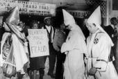 January 1964 Atlanta Georgia Ku Klux Klan members walk past black demonstators at a area of hotels and restaurants which were part of the segregation...
