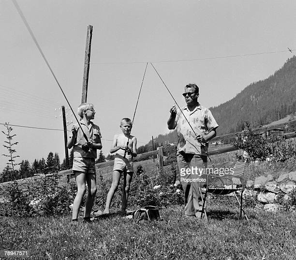 Politics Tyrol Austria August 1963 West Berlin Mayor Willy Brandt prepares for fishing whilst on holiday in the Alps in Aplbach With him are his son...