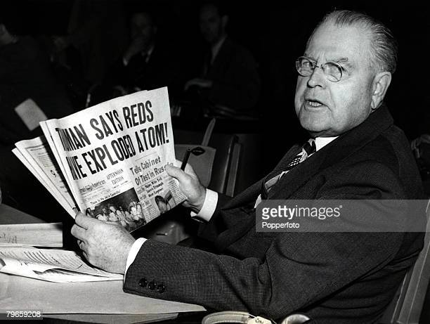 23rd September 1949 American representative Warren Austin the US Ambassador to the United Nations reading a newspaper headline with President Truman...