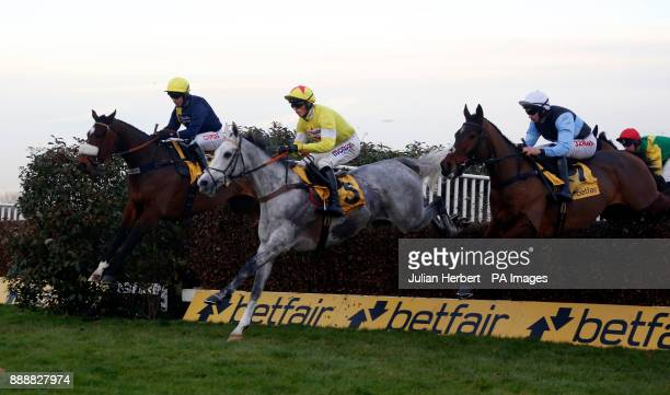 Politologue and Harry Cobden clear an early fence fence before going on to win The Betfair Tingle Creek Steeple Chase Race run during day two of the...