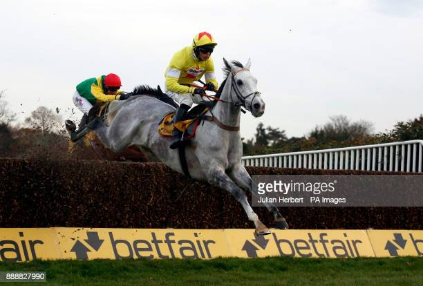 Politologue and Harry Cobden clear the last fence before going on to win The Betfair Tingle Creek Steeple Chase Race run during day two of the...