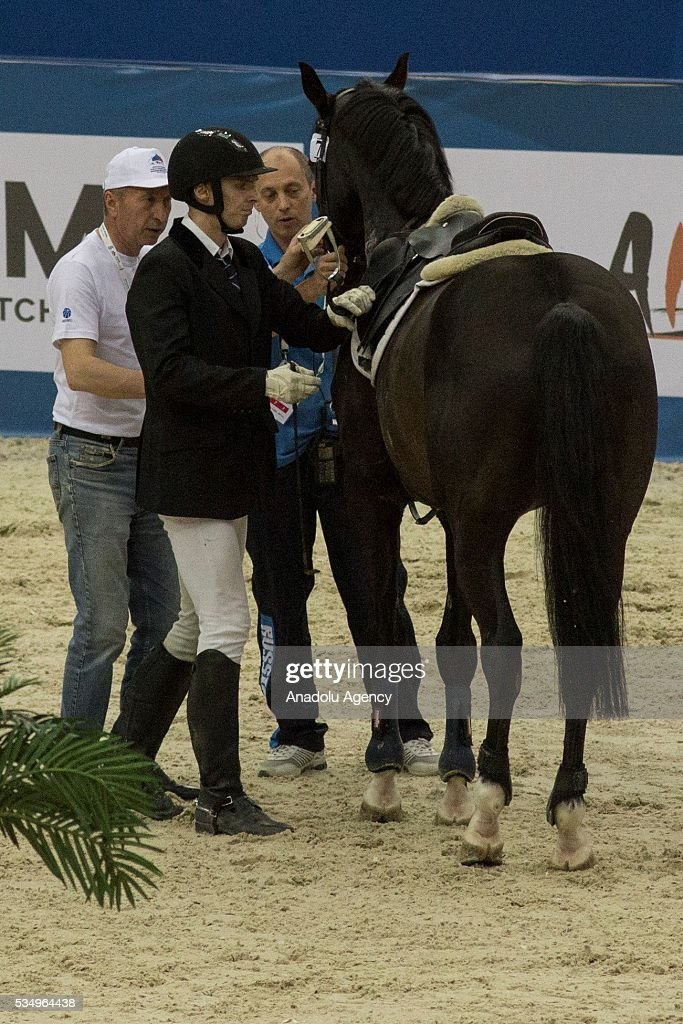 Polivka Ondrej of Czech Republic stands next to the horse after falling off the horse while competing in the men's riding final at the World Championship in modern pentathlon at the Olympic Sports Complex in Moscow, Russia, on May 28, 2016.