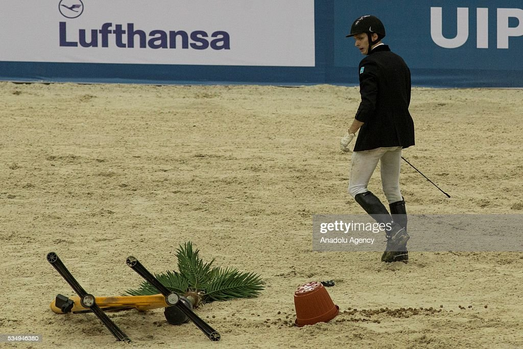 Polivka Ondrej of Czech Republic walks after falling off the horse while competing in the men's riding final at the World Championship in modern pentathlon at the Olympic Sports Complex in Moscow, Russia, on May 28, 2016.
