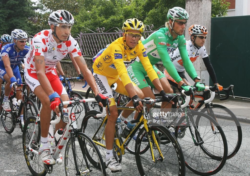 Polka Dot King of the Mountains jersey winner Juan Mauricio Soler Hernandez of Colombia and Barloworld Yellow Jersey Alberto Contador of Spain and...