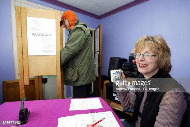 Poll Clerk Caroline Bishop has a cup of tea at a Polling Station in Chettisham Cambridgeshire in the bedroom of a family bungalow * Mrs Carmelia Bond...