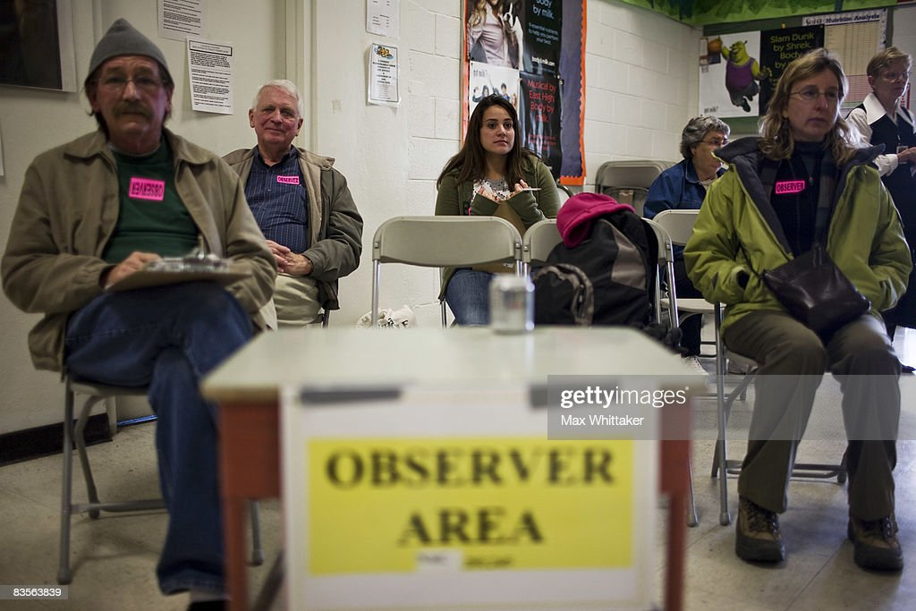 Poll observers watch voting at Peavine Elementary School November 4, 2008 in Reno, Nevada. After nearly two years of presidential campaigning, U.S. citizens go to the polls today to vote in the election between Democratic presidential nominee U.S. Sen. Barack Obama (D-IL) and Republican nominee U.S. Sen. John McCain (R-AZ).