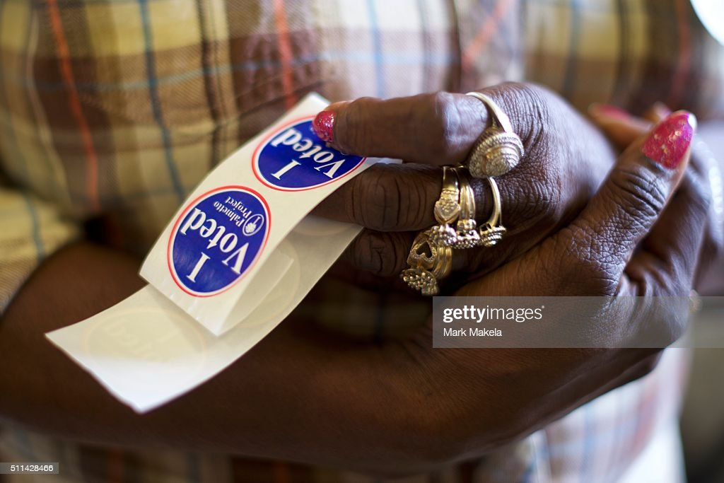 A poll station official holds 'I Voted' stickers at the Denmark Depot polling precinct on February 20, 2016 in Denmark, South Carolina. Statewide voters will cast ballots today in the South Carolina Republican Presidential Primary, the 'first in the south.'