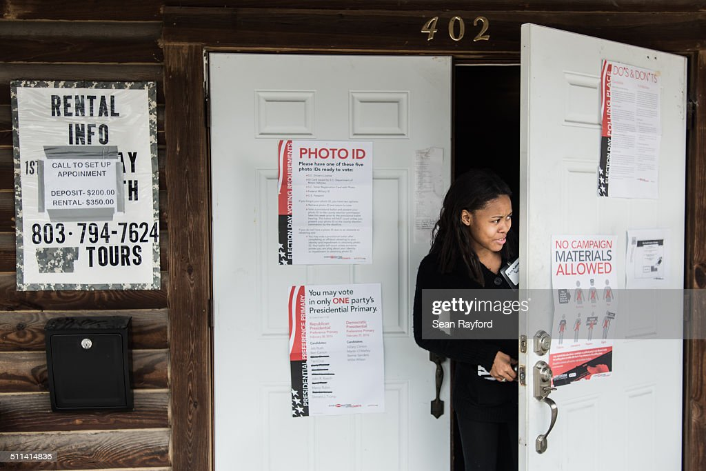 Poll worker Anntwanette Sulton peeks out the door at American Legion Memorial Cayce Post 130 on February 20, 2016 in Cayce, South Carolina. Today's vote is traditionally known as the 'First in the South' primary.