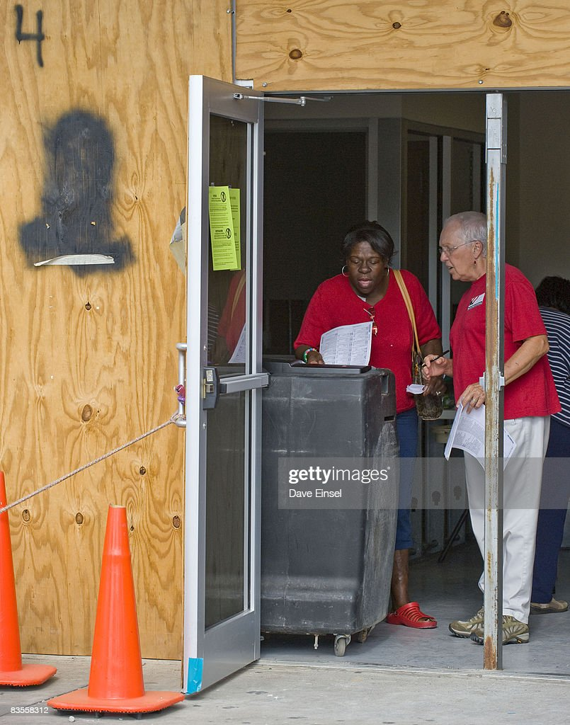 A poll worker (R) helps Pamela Phillips cast her ballot at polling station being renovated after damage from Hurricane Ike November 4, 2008 in Galveston, Texas. Voter turnout has been light as residents are still in the process of rebuilding after Ike. After nearly two years of presidential campaigning, U.S. citizens go to the polls today to vote in the election between Democratic presidential nominee U.S. Sen. Barack Obama (D-IL) and Republican nominee U.S. Sen. John McCain (R-AZ).
