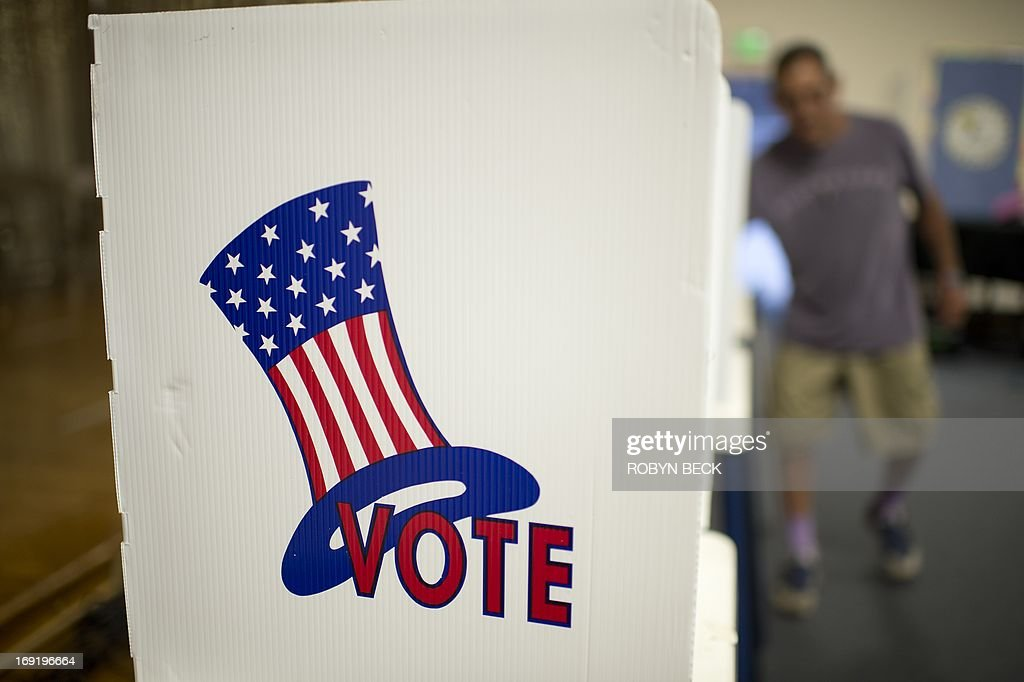 A poll worker prepares voting booths at a polling station in Los Angeles on May 21 2013 Los Angeles City Controller Wendy Greuel and Councilman Eric...