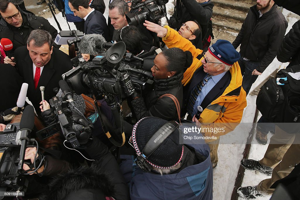 A poll worker (in yellow) tells Republican presidential candidate New Jersey Governor <a gi-track='captionPersonalityLinkClicked' href=/galleries/search?phrase=Chris+Christie&family=editorial&specificpeople=6480114 ng-click='$event.stopPropagation()'>Chris Christie</a> to move away from the area because he and the news media following him are blocking the way for voters outside the polling place at Webster School February 9, 2016 in Manchester, New Hampshire. Candidates from both parties are making last-minute attempts to swing voters to their side on the day of the 'First in the Nation' presidential primary.