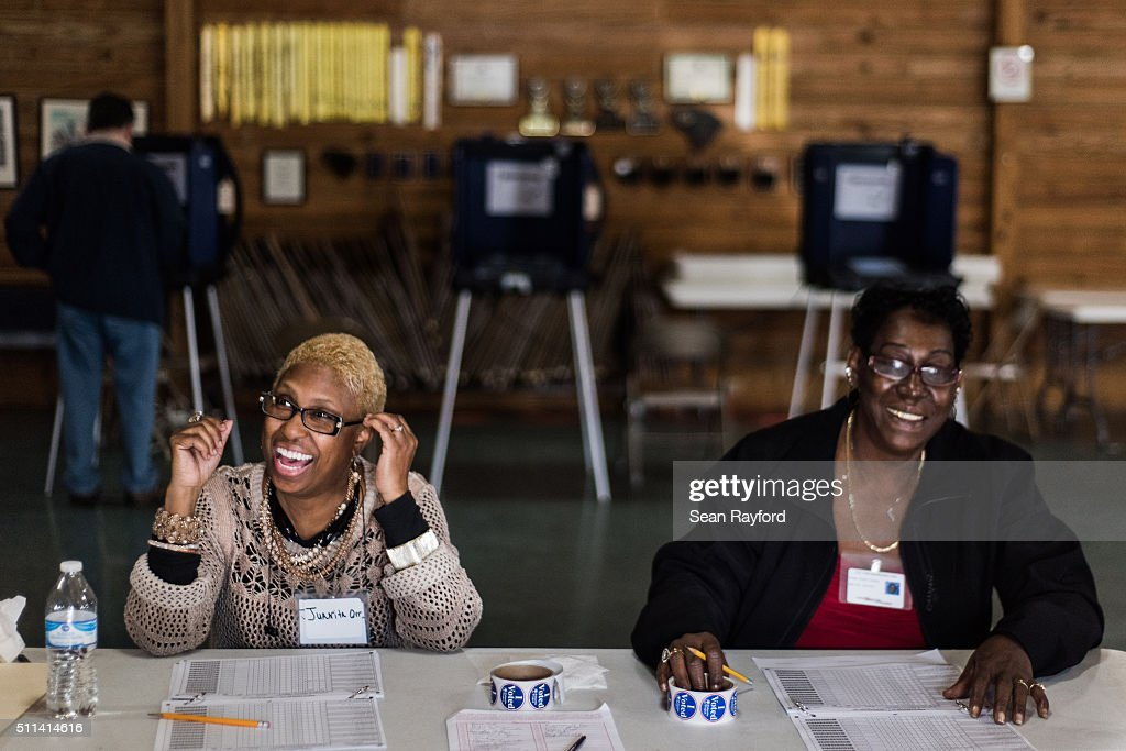 Poll workers Juanita Orr left and Dianna Stephens share a laugh with Republican presidential primary voters in an American Legion post on February 20...