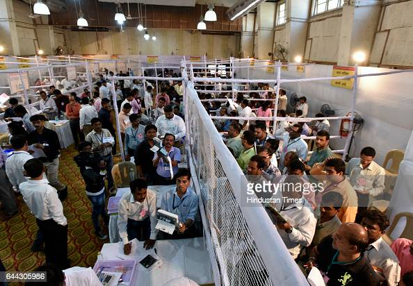 Polling agent showing EMV at counting booth at Dadar on February 23 2017 in Mumbai India The BJP has won 82 of the councils 227 seats and eight out...