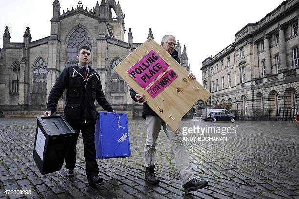 Polling Manager Scott Russel and assistant Ross Clement deliver ballot boxes and a polling sign to a polling station on The Royal Mile in the centre...