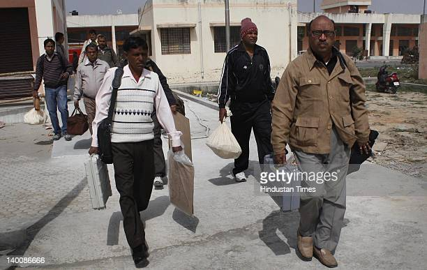Polling officers carrying electronic voting machines out of EVM distribution centre on February 27 2012 in Noida India Polling for the sixth phase...