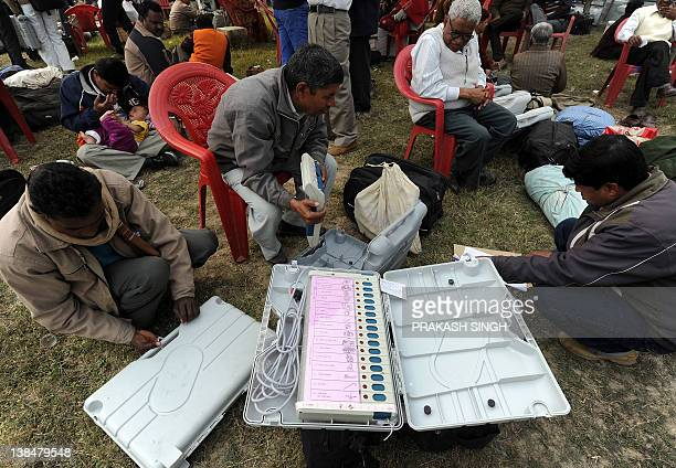 Polling officers check Electronic Voting Machines at an EVM distribution centre in Faizabad Uttar Pradesh state on February 7 2012 With Uttar Pradesh...