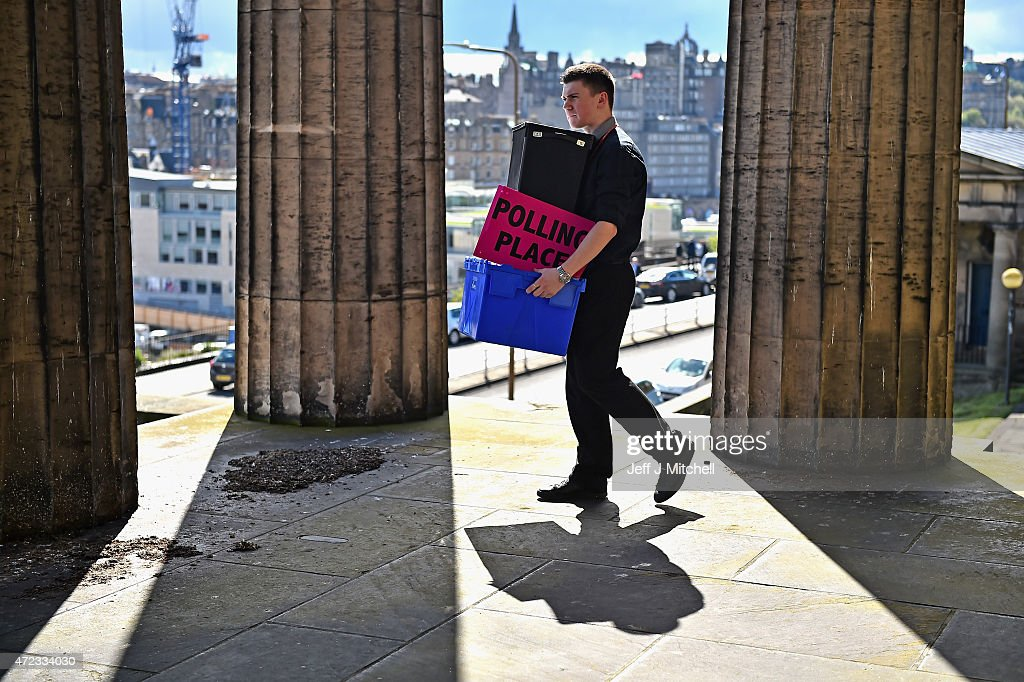 Polling station assistant Ross Clement loads ballot boxes at New Parliament House onto vans for delivery to the 145 polling stations across the city on May 6, 2015 in Edinburgh, Scotland.With less than 24 hours until the polls open politicians campaign across the country in the final push for votes.