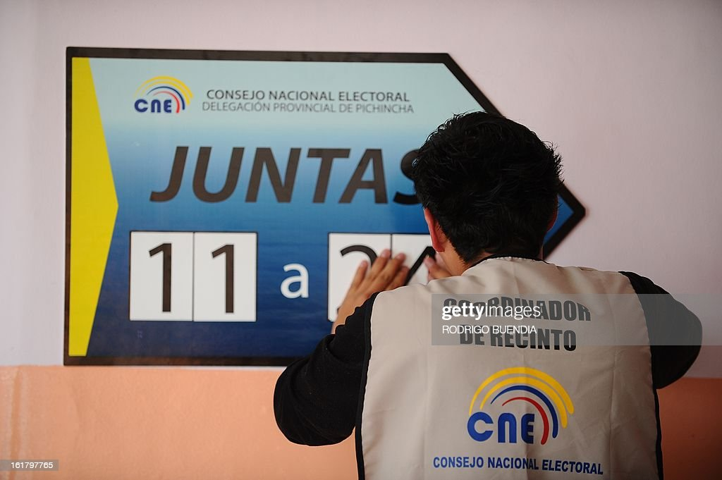 A polling station coordinator prepares the necessary material for Sunday's general elections, on February 16, 2013 in Quito. Tomorrow 11,7 million Ecuadoreans will elect their president and 142 lawmakers.