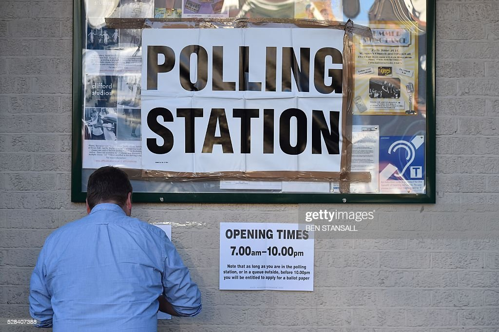 A Polling Station is prepared ahead of voting in Barnes, south-west London on May 5, 2016. Londoners go to the polls on Thursday to elect their new mayor following a bitter campaign between the two leading candidates, Goldsmith, and Labour's Sadiq Khan, that stayed ugly to the very end. While London chooses a new mayor, there are also elections to the Scottish, Welsh and Northern Irish assemblies, and 124 local authorities scattered across England. / AFP / BEN