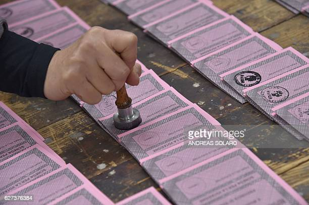 A polling station officer prepares ballots on the eve of a crucial referendum on constitutional reforms on December 3 2016 in Rome At stake on...