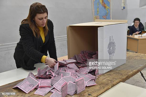 A polling station officer prepares the counting of the ballots at the end of the vote for a referendum on constitutional reforms on December 4 2016...