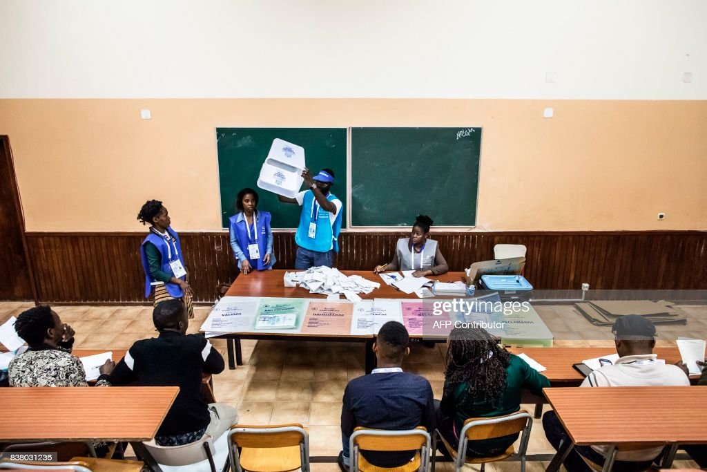 A polling station official shows an empty ballot box during the counting of votes at the end of the general election in Luanda, on August 23, 2017. Angolans voted on August 23 in an election marking the end of President Jose Eduardo dos Santos's 38-year reign, with his MPLA party set to retain power despite an economic crisis. /