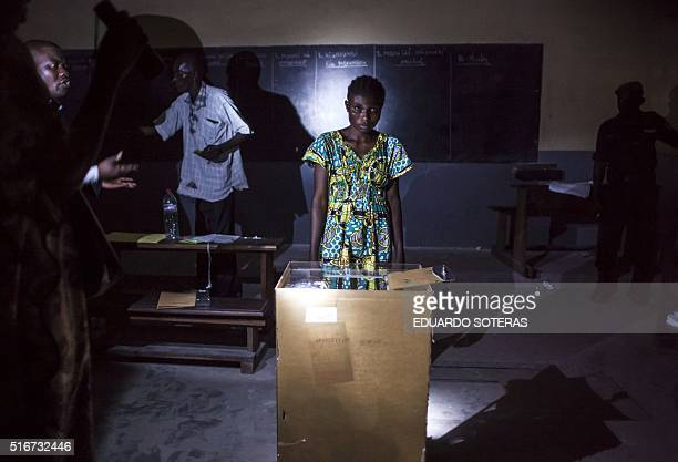 Polling station officials at the Pierre Ntsiete Primary School in Brazzaville prepare to count ballots at the end of the vote for the presidential...