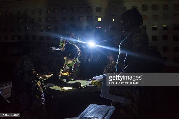 TOPSHOT Polling station officials at the Pierre Ntsiete Primary School in Brazzaville prepare to close the polling stations during the vote for the...