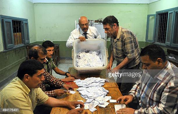 Polling station officials count ballots in the Egyptian city of Alexandria on May 28 2014 at the end of voting in the presidential election The...