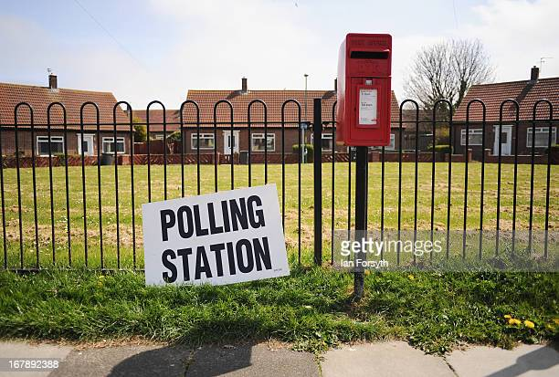 A polling station sign is attached to a fence outside one of the 45 polling stations in South Shields on the day that voters go to the polls on May 2...