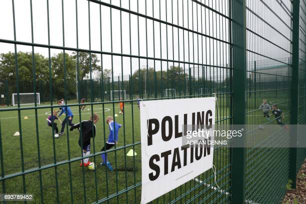 A polling station sign is pictured at a sports centre in Fleet west of London on June 8 as Britain holds a general election Britain went to the polls...