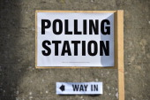 A Polling Station sign is seen near Biggin Hill south of London on May 22 2014 Europe's mammoth parliamentary elections kicked off on Thursday with...