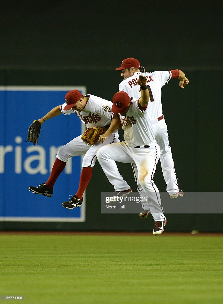 AJ Pollock #11, <a gi-track='captionPersonalityLinkClicked' href=/galleries/search?phrase=Gerardo+Parra&family=editorial&specificpeople=4959447 ng-click='$event.stopPropagation()'>Gerardo Parra</a> #8 and <a gi-track='captionPersonalityLinkClicked' href=/galleries/search?phrase=Tony+Campana&family=editorial&specificpeople=7800014 ng-click='$event.stopPropagation()'>Tony Campana</a> #19 of the Arizona Diamondbacks celebrate a 5-4 win against the Philadelphia Phillies at Chase Field on April 25, 2014 in Phoenix, Arizona.