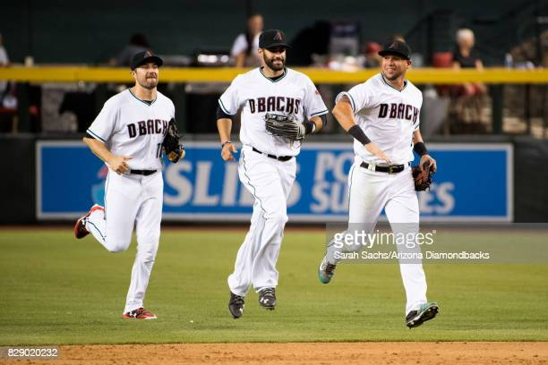 J Pollock JD Martinez and David Peralta of the Arizona Diamondbacks celebrate after defeating the Dodgers 63 at Chase Field on August 8 2017 in...