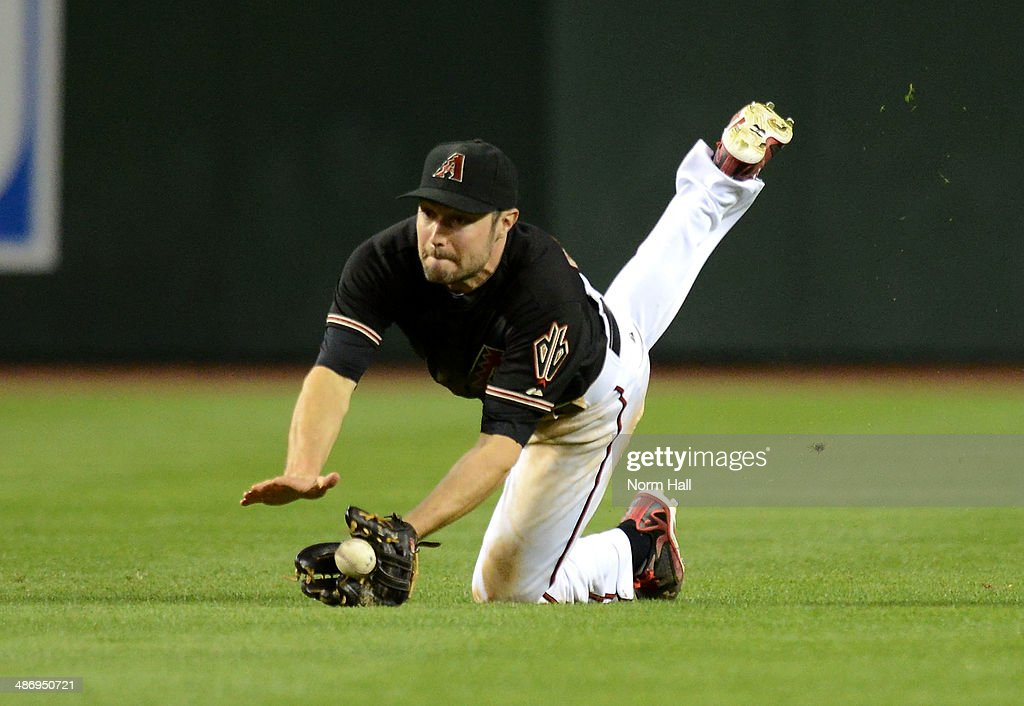 AJ Pollock #11 of the Arizona Diamondbacks attempts a diving catch in the eighth inning against the Philadelphia Phillies at Chase Field on April 26, 2014 in Phoenix, Arizona.