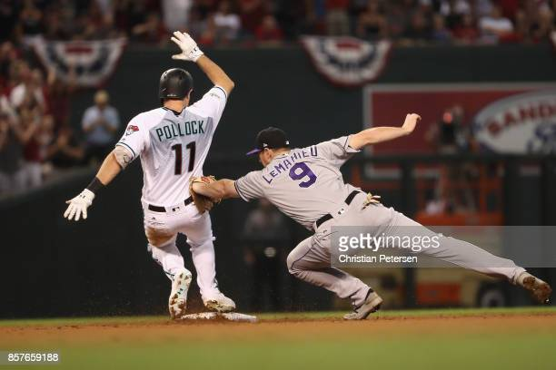 J Pollock of the Arizona Diamondbacks beats the tag from DJ LeMahieu of the Colorado Rockies during the bottom of the first inning of the National...