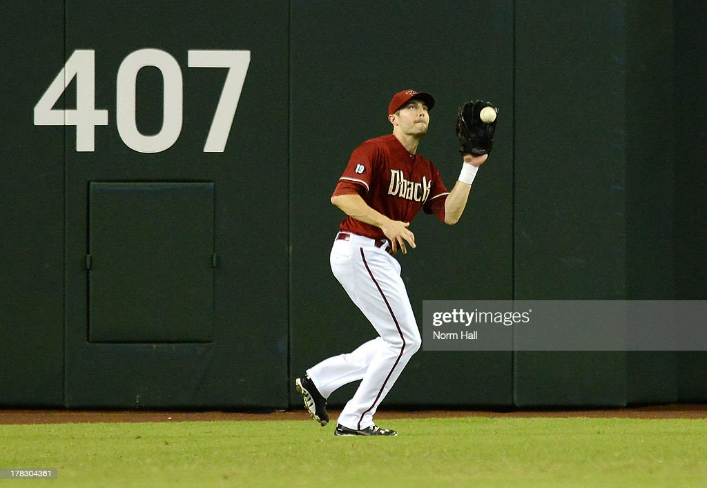 AJ Pollock #11 of the Arizona Diamondbacks catches a fly ball against the San Diego Padres at Chase Field on August 28, 2013 in Phoenix, Arizona.